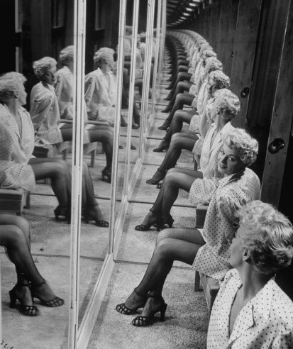 Shelley Winters in a booth with mirrors, 1949