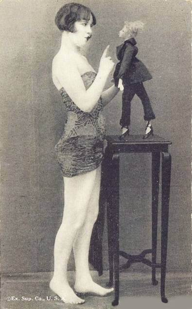 1920 ca postcard-chcago-arcade-card-exhibit-supply-company-pin-up-woman-by-table-with-woman-puppet-