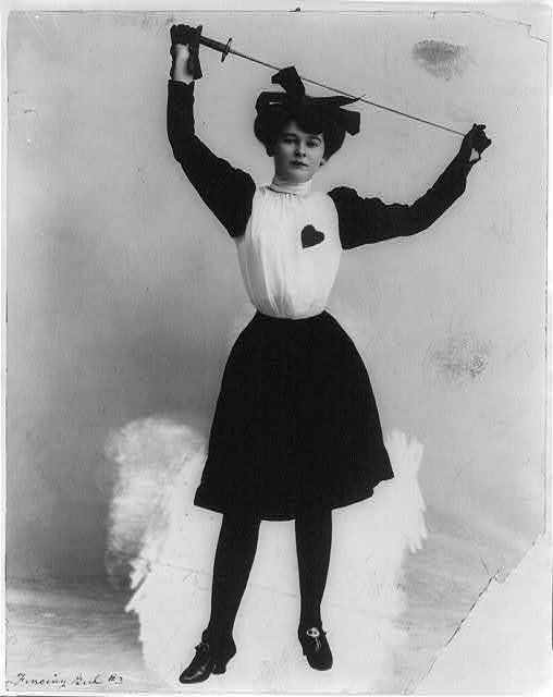 PhotoFencing-girlYoung-woman-holding-epee-above-headc1903